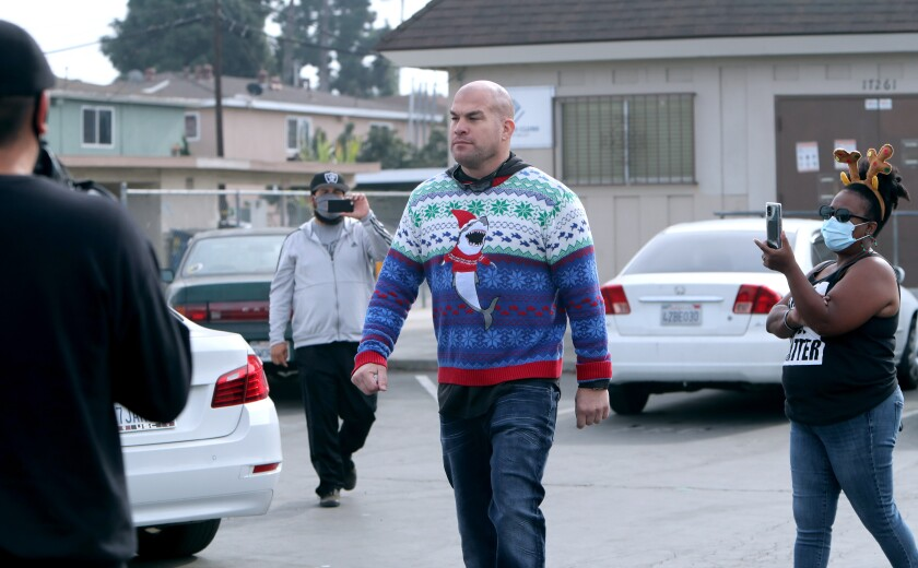 Huntington Beach Mayor Pro Tem Tito Ortiz without a mask at a food giveaway.