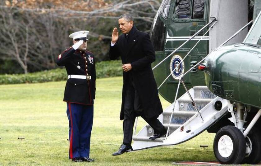 "President Obama steps off Marine One upon his return to Washington, where efforts to head off the looming ""fiscal cliff"" have taken center stage."