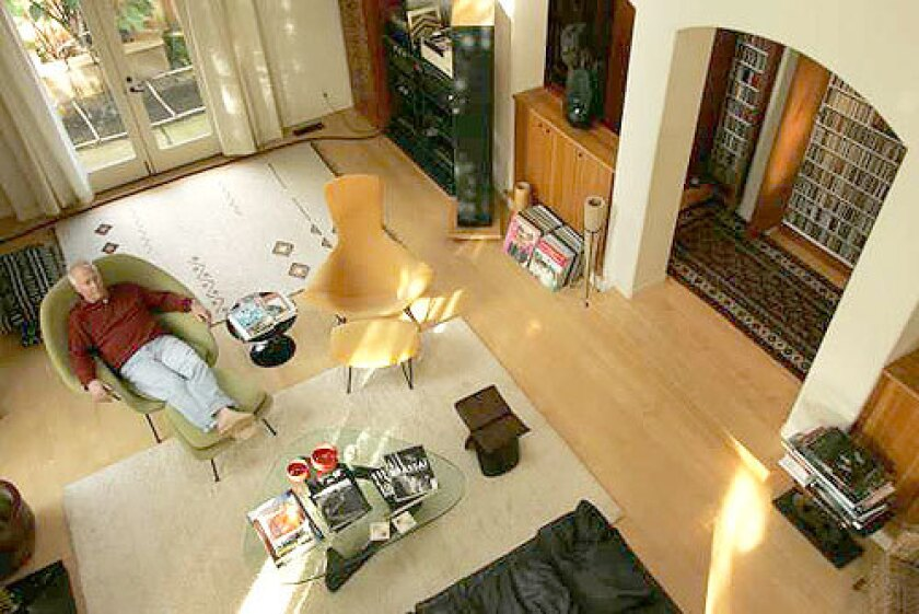 """HARMONIOUS LIVING: Schnabel, host of KCRW's """"Café L.A.,"""" soaks up the melodies in the listening room of his spacious two-story house. """"This house was built around my passion,"""" he says."""