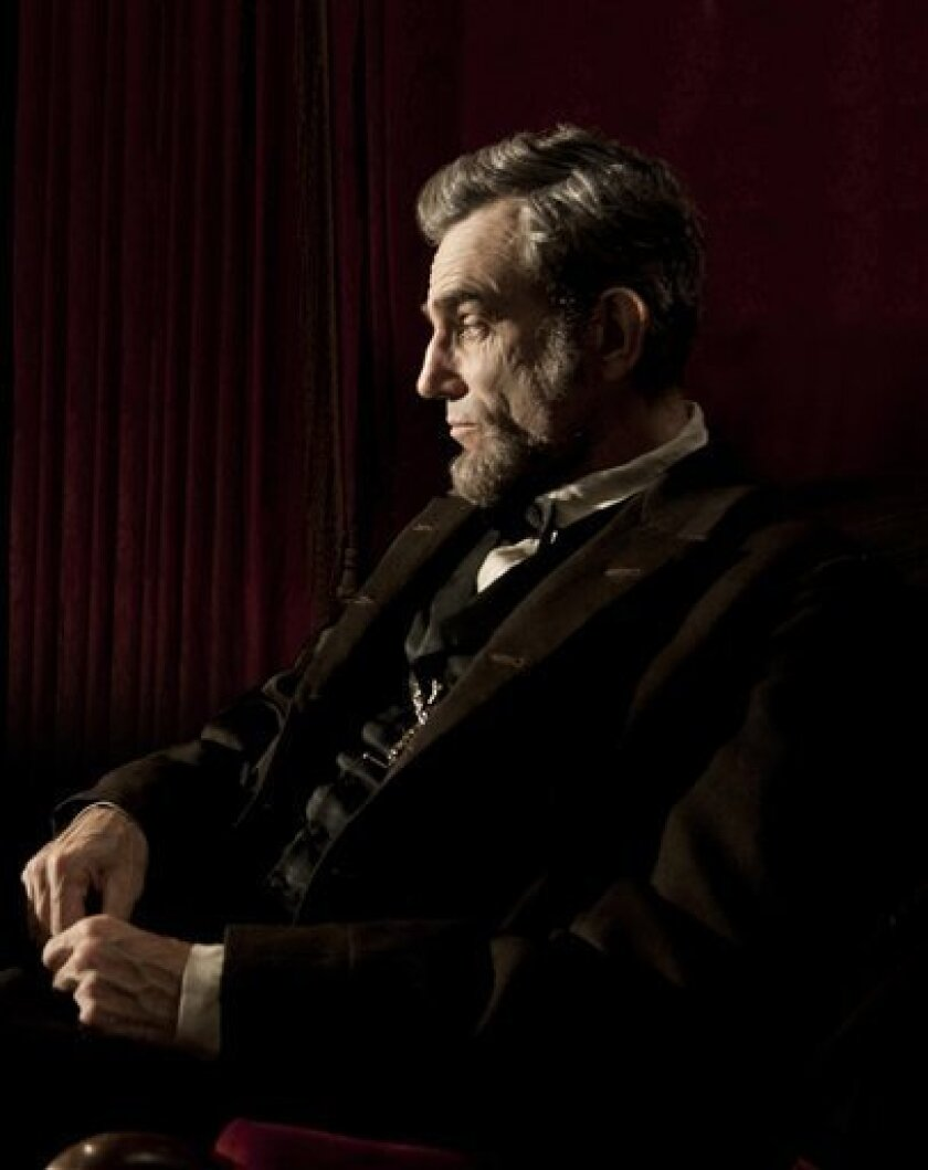 """This publicity film image released by Walt Disney Pictures shows Daniel Day-Lewis portraying Abraham Lincoln in the film """"Lincoln.""""  The film, directed by Steven Spielberg, opens in limited release Nov. 9 and nationwide Nov. 16, just after the U.S. presidential election. (AP Photo/Disney-DreamWorks"""