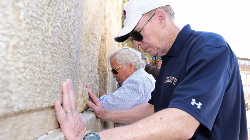 Hall of Fame quarterback Roger Staubach and Robert Kraft pray at the Western Wall in Jerusalem.