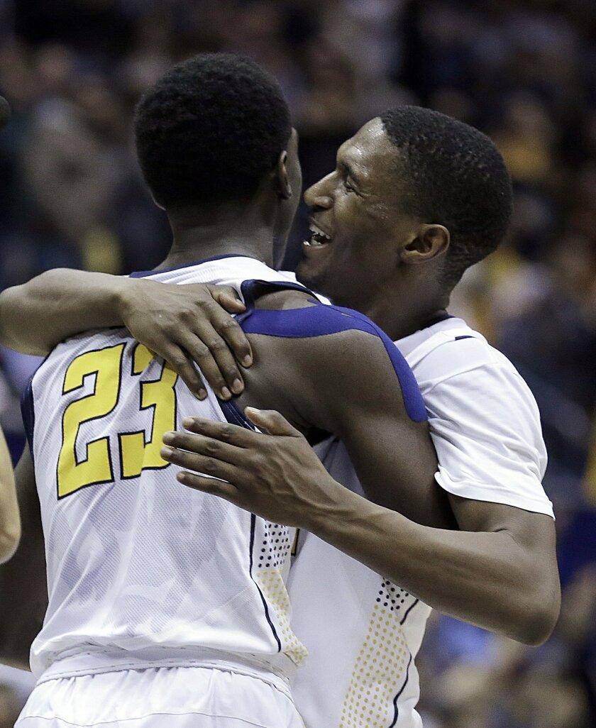 California's Jordan Mathews, right, embraces Jabari Bird (23) after a 75-70 win over Arizona State in an NCAA college basketball game Thursday, Jan. 21, 2016, in Berkeley, Calif. (AP Photo/Ben Margot)