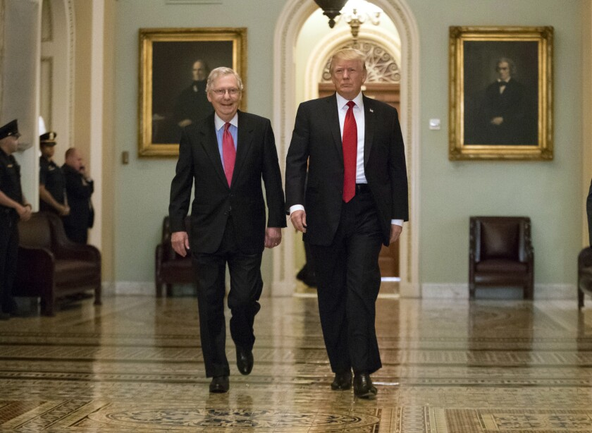 President Donald Trump, escorted by Senate Majority Leader Mitch McConnell, R-Ky.,.