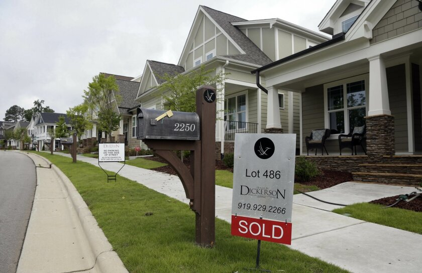 FILE - In this Tuesday, June 9, 2015, file photo, a sold sign is displayed in the yard of a newly constructed home in the Briar Chapel community in Chapel Hill, N.C. On Thursday, Jan. 21, 2016, Freddie Mac reports on the week's average U.S. mortgage rates. (AP Photo/Gerry Broome, File)