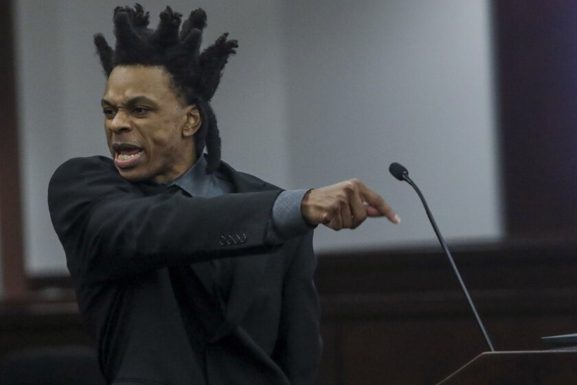 Ronnie Oneal III becomes emotional while representing himself during closing arguments for his murder trial at the George E. Edgecomb Courthouse in Tampa, Fla., on Monday, June 21, 2021. (Ivy Ceballo/Tampa Bay Times via AP)