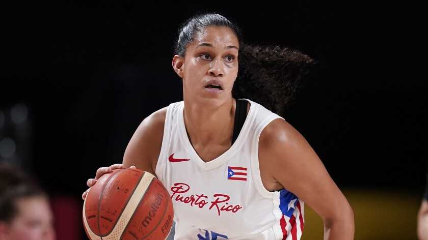 Puerto Rico's Isalys Quinones dribbles a basketball while looking up.