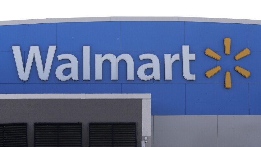 In this Sept. 3, 2019 file photo, a Walmart logo is displayed outside of a Walmart store, in Walpole, Mass. Walmart says it will stop selling electronic cigarettes at its namesake stores and Sam's Clubs following a string of illnesses and deaths related to vaping.