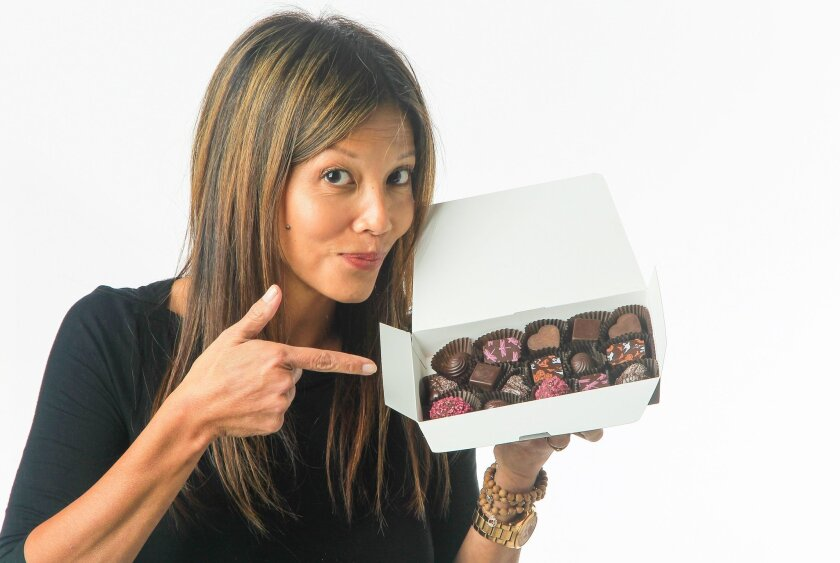 Tess Brown, owner of Chi Chocolat, displays her chocolates at the UT  on Friday San Diego, California.