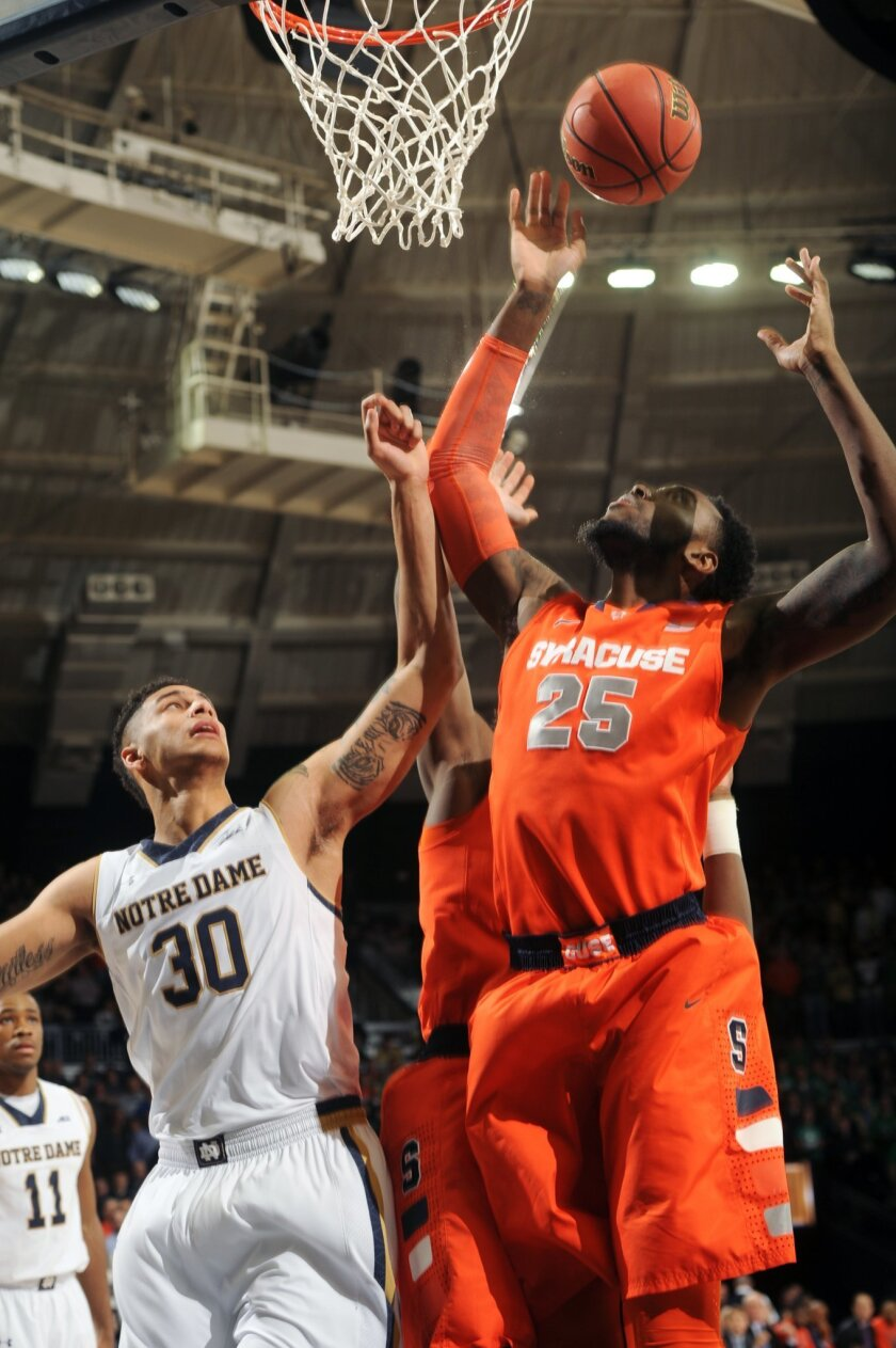Syracuse forward Rakeem Christmas (25) shoots over Notre Dame forward Zach Auguste (30) in the first half of an NCAA college basketball game Tuesday, Feb. 24, 2015, in South Bend, Ind. (AP Photo/Joe Raymond)