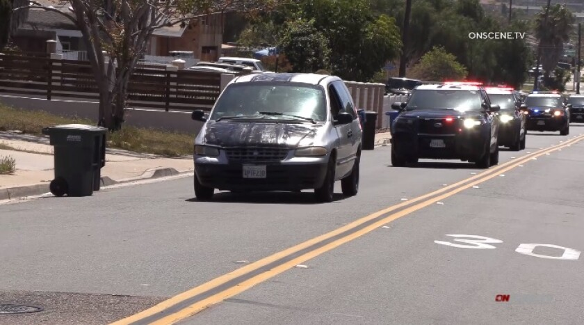 Chula Vista police vehicles pursue a minivan Thursday afternoon. The chase lasted about an hour and 45 minutes.