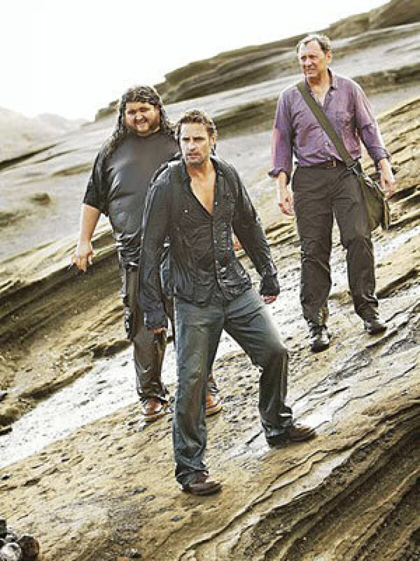 """Jorge Garcia, left rear, Josh Holloway and Michael Emerson in the last episode of the ABC drama """"Lost,"""" which aired Sunday night."""