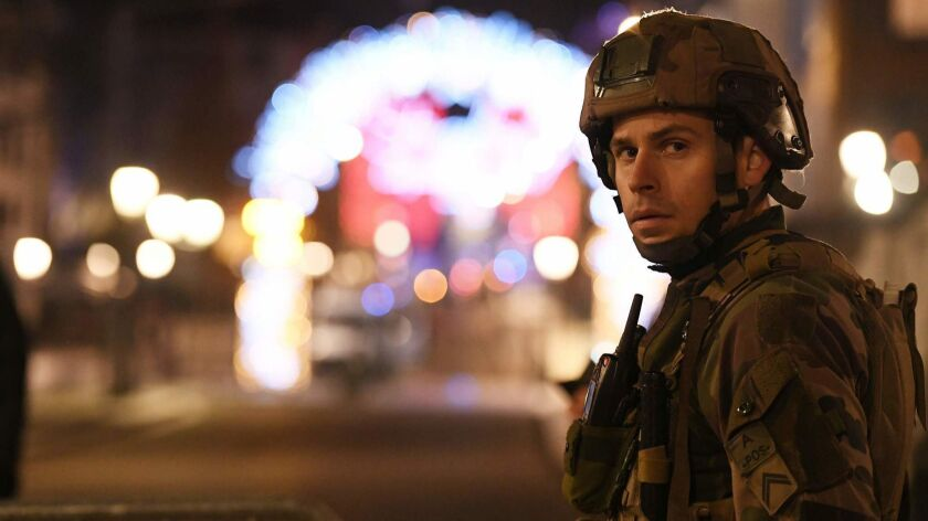 Military personnel are deployed near the Christmas market in Strasbourg, France, after a deadly shooting.