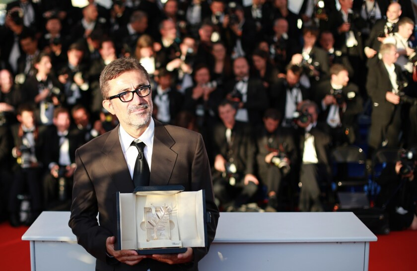 "Turkish director Nuri Bilge Ceylan with the Palme d'Or he won for the film ""Winter Sleep"" at Cannes."