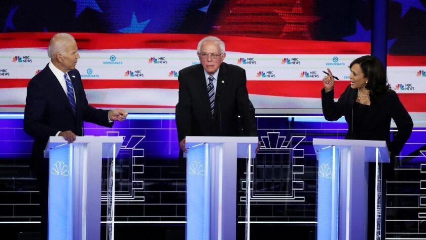 MIAMI, FLORIDA - JUNE 27: Sen. Kamala Harris (R) (D-CA) and former Vice President Joe Biden (L) spea
