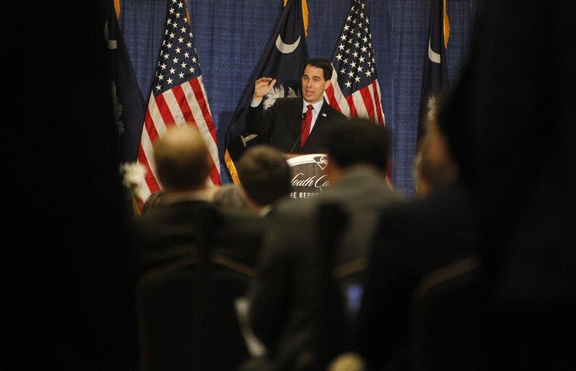He runs, Wisconsin's economy fades: Wisconsin Gov. Scott Walker at a recent political luncheon.
