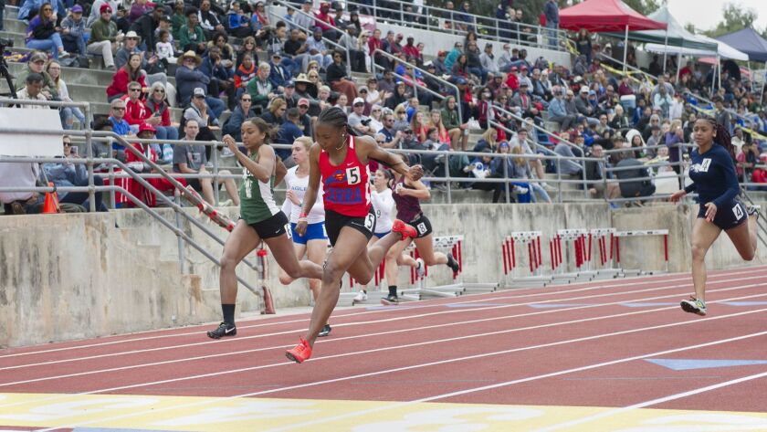 Jazmyne Frost, number 5, of Serra High School in Gardena, CA, competes in the Girls 100 Meter Dash a