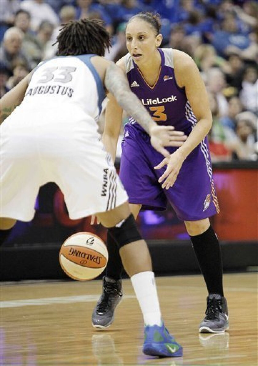 Phoenix Mercury guard Diana Taurasi (3) looks to drive past Minnesota Lynx guard Seimone Augustus (33) in the second half of a WNBA basketball game, Wednesday, July 13, 2011, in Minneapolis. Phoenix defeated Minnesota 112-105. (AP Photo/Stacy Bengs)