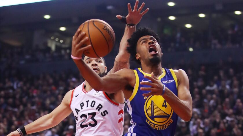 Warriors guard Quinn Cook drives past Raptors guard Fred VanVleet for a layup during Game 1 of the NBA Finals on May 30, 2019.
