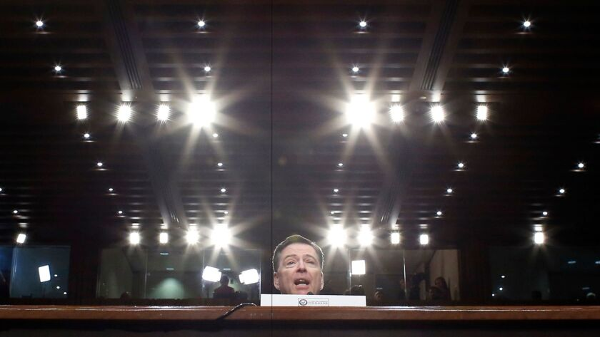 Former FBI Director James Comey speaks during a Senate Intelligence Committee hearing on Capitol Hill on June 8 in Washington.