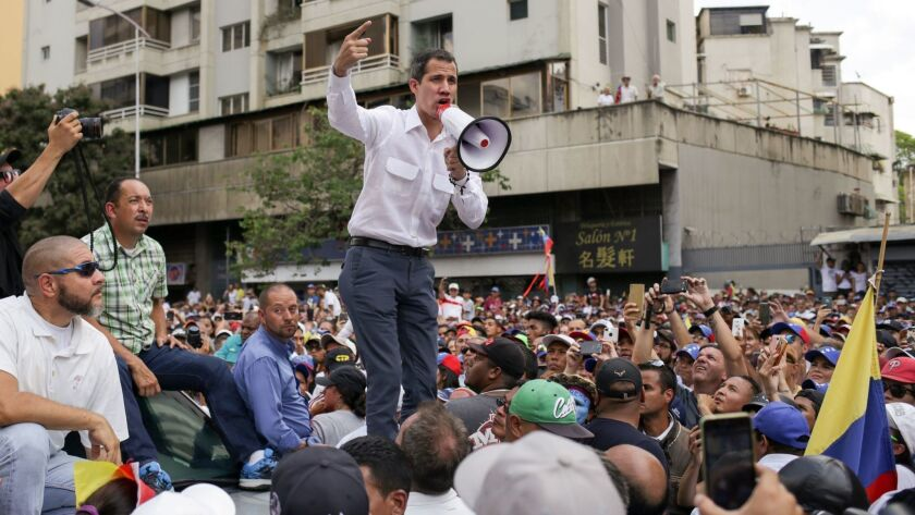 Venezuelan opposition leader and self-proclaimed acting President Juan Guaido speaks during a demonstration in Caracas on March 9, 2019.