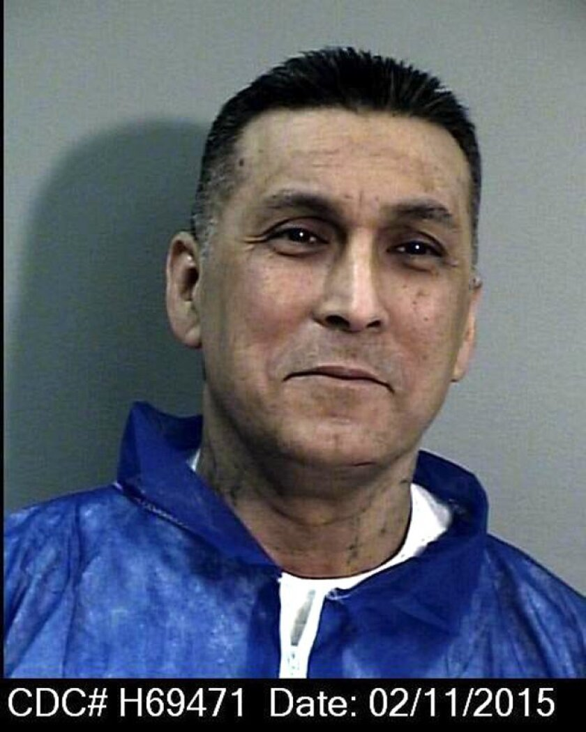"This image provided by the California Department of Corrections shows a photo of Rene ""Boxer"" Enriquez. Gov. Jerry Brown announced Friday Feb. 20, 2015 he has blocked parole for the former leader of the notorious Mexican Mafia prison gang who has turned on his former comrades and now aids law enforcement. Enriquez has been in prison since 1993 serving a sentence of 20 years-to life in prison for two murders, multiple assaults and conspiracy to traffic in controlled substances. (AP Photo/California Department of Correction)"