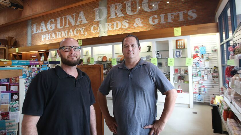 Mark Bastia, left, and Josh Meili, spend stand at Laguna Drugs which will soon close in downtown Lag