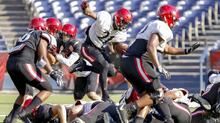San Diego State running back Chance Bell hurdles the line during a carry in the first half of the team's scrimmage Saturday at SDCCU Stadium.