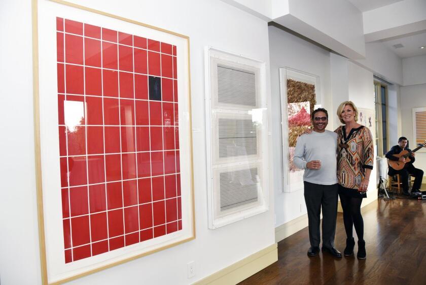 Featured artist Joe Rojas, property listing agent Janet Lawless Christ