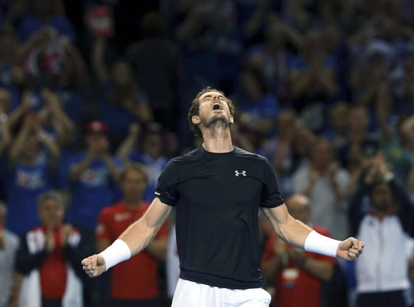 Britain's Andy Murray celebrates winning his match against Australia's Bernard Tomic at the end of his semifinal tennis match of the Davis Cup between Britain and Australia in Glasgow, Scotland Sunday Sept. 20, 2015. (AP Photo/Scott Heppell)