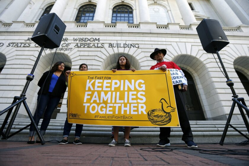 Immigration activists protest outside the federal appeals court in New Orleans on Oct. 14, 2015.