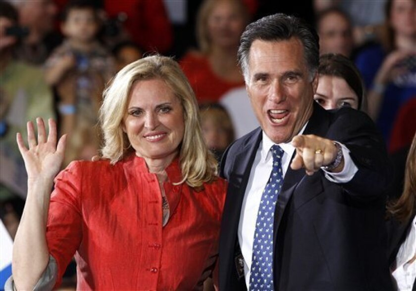 Republican presidential candidate, former Massachusetts Gov. Mitt Romney, stands with his wife Ann as he celebrates his Florida primary election win at the Tampa Convention Center in Tampa, Fla., Tuesday, Jan. 31, 2012. (AP Photo/Charles Dharapak)