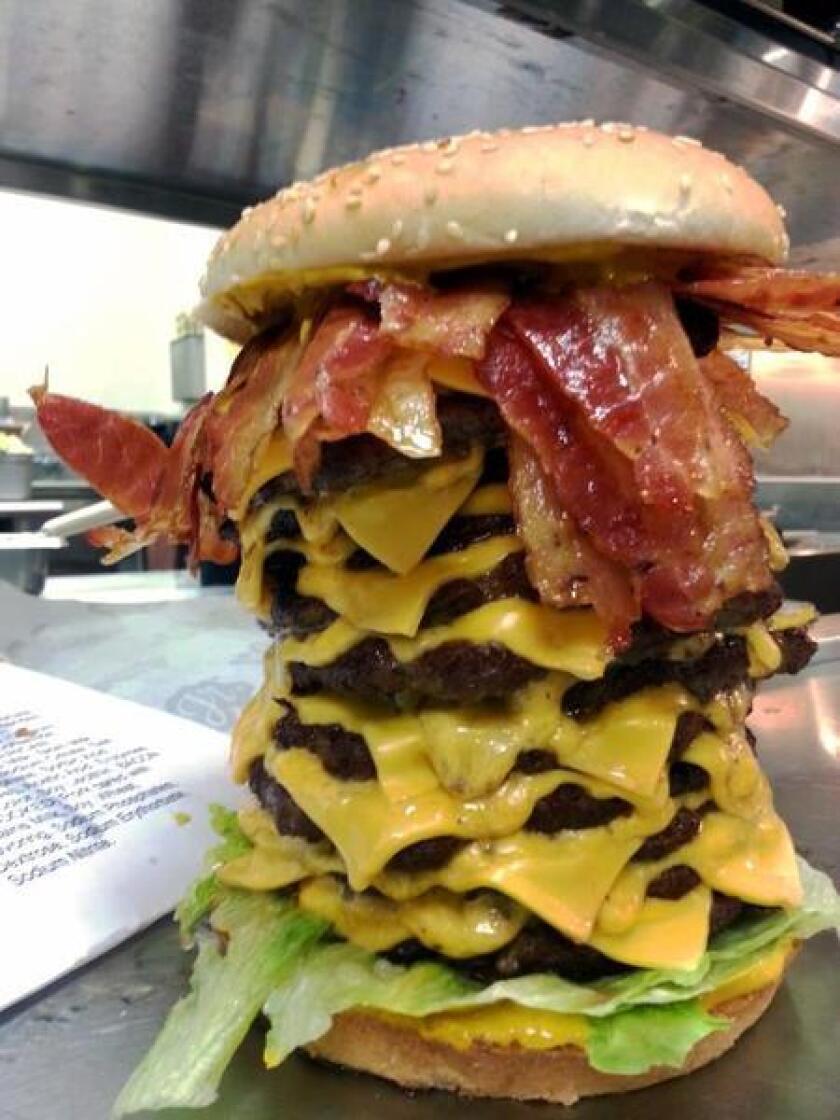 The 12x12x12 burger in Carl's Jr.'s test kitchen. The fast-food chain calls it #burgergeddon.