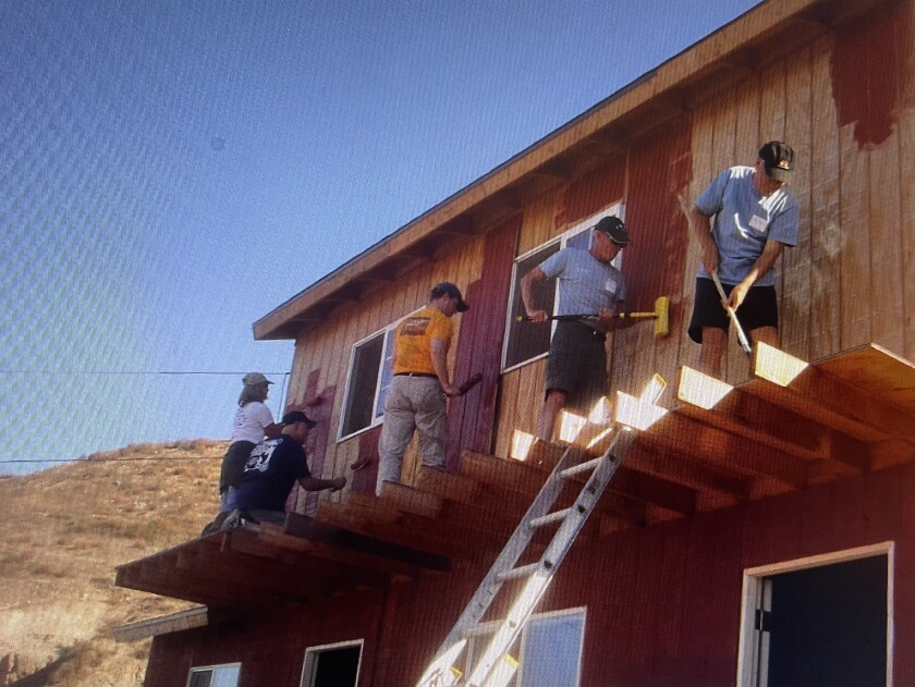 Rotarians helping paint the community center in Carretas.