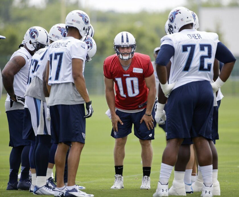 FILE -- This July 27, 2014 file photo shows Tennessee Titans quarterback Jake Locker (10) calling a play during NFL football training camp in Nashville, Tenn. Locker says he's financially set for life thanks to his rookie NFL contract. His motivation to win games remains strong as ever, and the Tennessee quarterback goes into the final year of that deal needing to prove he can stay on the field long enough to lead the Titans. (AP Photo/Mark Humphrey, File)