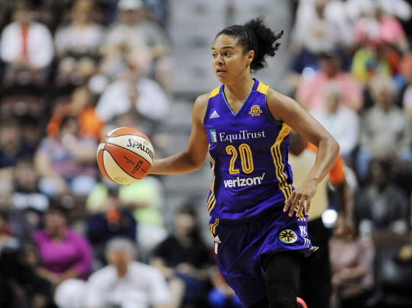 Sparks guard Kristi Toliver brings the ball up the court during a game in 2016.