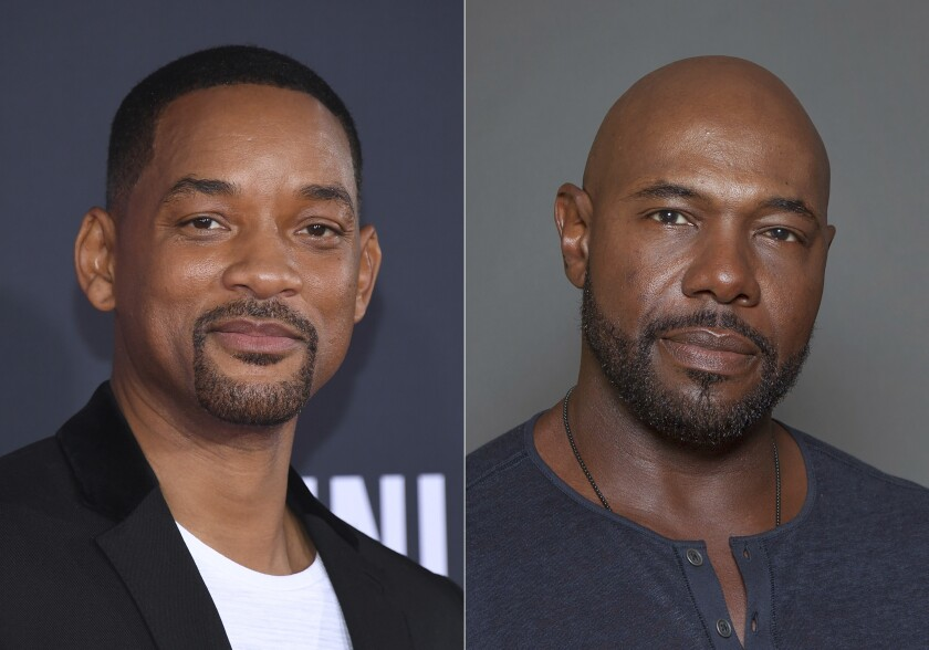 "Will Smith attends the premiere of ""Gemini Man"" in Los Angeles on Oct. 6, 2019, left, and director Antoine Fuqua appears during a photo session in Los Angeles on July 12, 2015. Smith and director Fuqua have pulled production of their runaway slave drama ""Emancipation"" from Georgia over the state's recently enacted law restricting voting access. The film is largest and most high profile Hollywood production to depart the state since Georgia's Republican-controlled state Legislature passed a law that introduced stiffer voter identification requirements for absentee balloting. (AP Photo)"