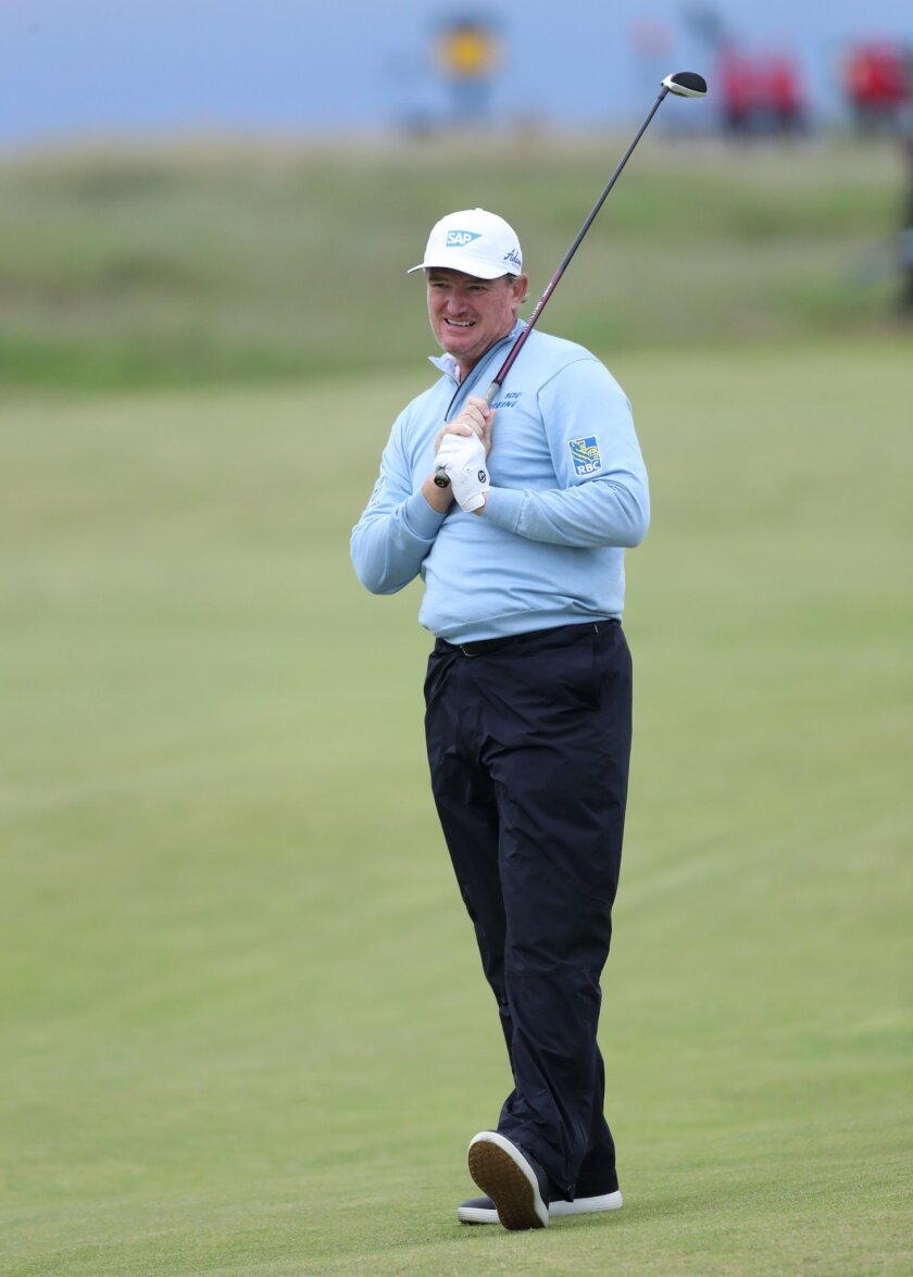 Ernie Els of South Africa reacts to his shot from the 3rd fairway during the second round of the British Open Golf Championship at the Royal Troon Golf Club in Troon, Scotland, Friday, July 15, 2016. (AP Photo/Peter Morrison)