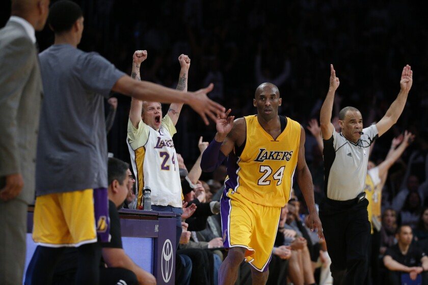 Lakers fans including Flea, celebrate after Kobe Bryant hits a three pointer late in the fourth quarter of a game against the Timberwolves on Feb. 2. at Staples Center.