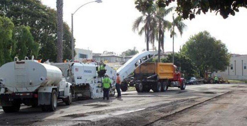 Crews work on repaving Pearl Street on Nov. 21. Photo: Dave Schwab