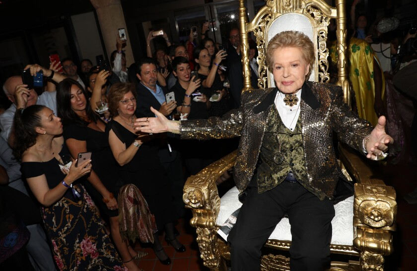 Walter Mercado is seen at the opening of an exhibition about his life in Miami.