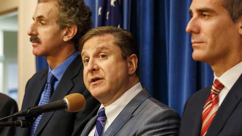 Los Angeles City Controller Ron Galperin is flanked by City Atty. Mike Feuer, left, and Mayor Eric Garcetti in 2015.