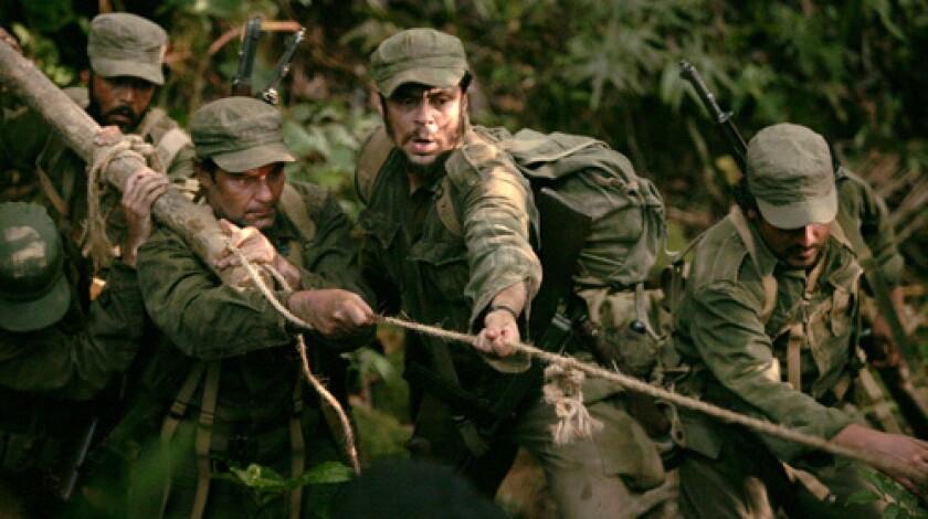 EQUALS: Che Guevara (Benicio Del Toro, center) struggles with fellow insurgents.
