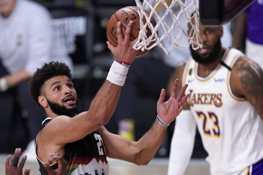 Denver Nuggets guard Jamal Murray puts up a shot during a 114-106 win over the Lakers.