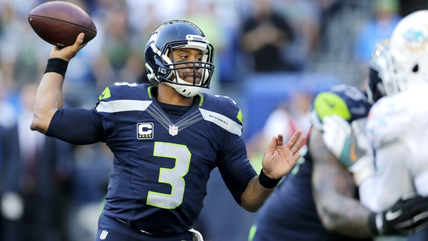 Russell Wilson and the Seahawks will try to improve to 7-3-1 when hosting the Eagles on Sunday.