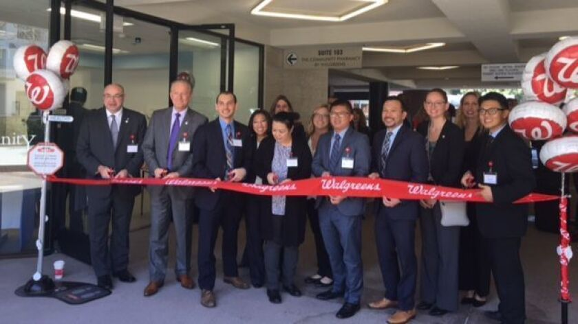Managers, pharmacists, Walgreens employees and local government representatives cut the ribbon on the new Walgreens Community Pharmacy at 4130 La Jolla Village Drive, Feb. 9. Stores hours are 9 a.m. to 5 p.m. weekdays.