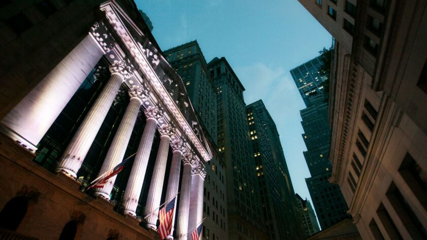 The Dow Jones industrial average rose 63.21 points, or 0.3%, to 24,837.51 on Thursday, its 71st record high this year. Above, the New York Stock Exchange.