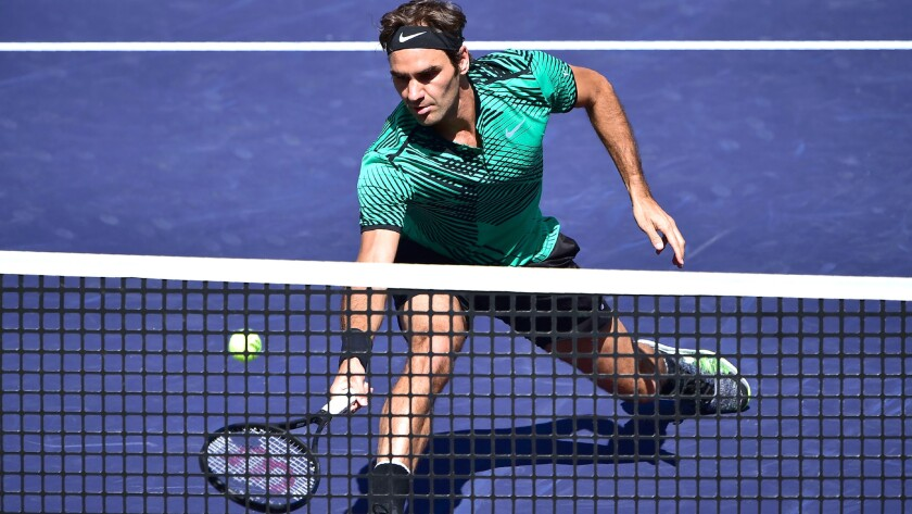 Roger Federer races to the net to make a volley during his semifinal match against Jack Sock on Saturday at the BNP Paribas Open.