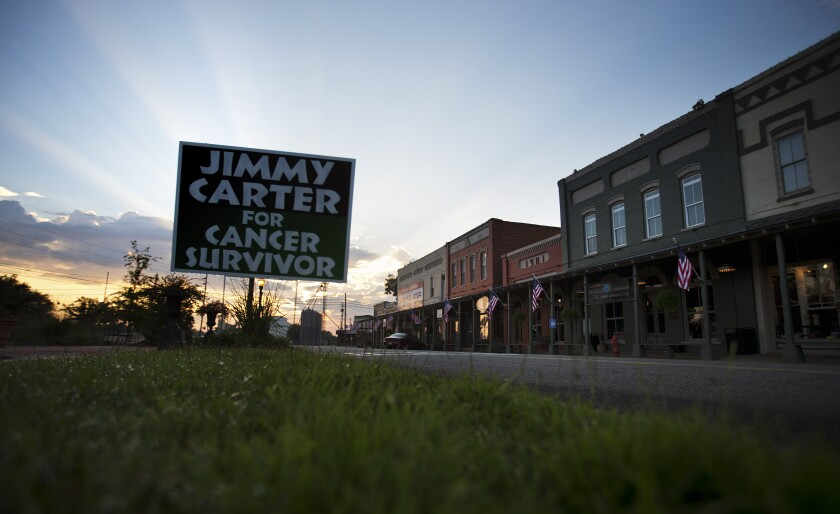 A sign along Main Street in Plains, Ga., cheers President Carter on in his  fight against cancer in 2015.