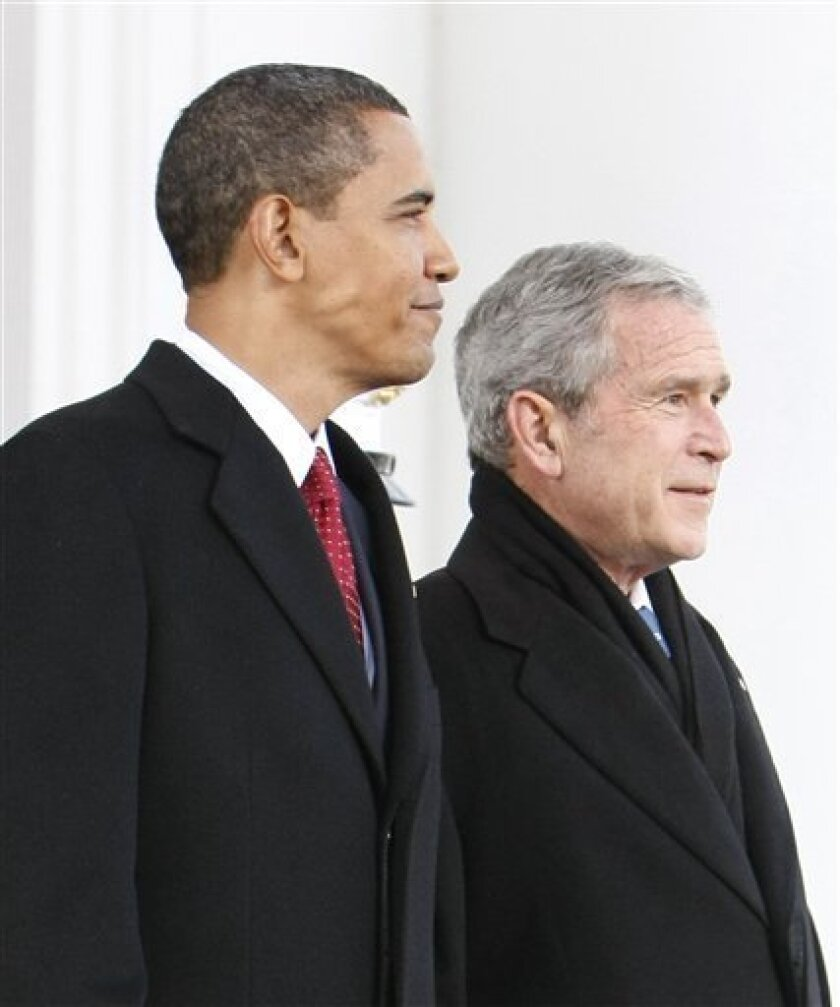 President Bush, right, walks out with President-elect Barack Obama, left, on the North Portico of the White House before sharing the Presidential limousine en route to Capitol Hill for the inauguration of the President-elect in Washington, Tuesday, Jan. 20, 2009.(AP Photo/Pablo Martinez Monsivais)