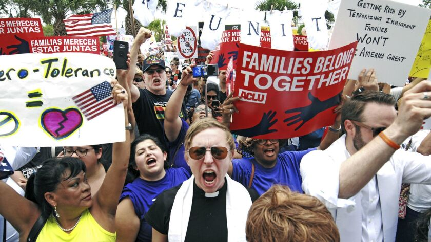 "FILE - In this June 28, 2018 file photo, protesters chant ""Families belong together!"" as they walk t"